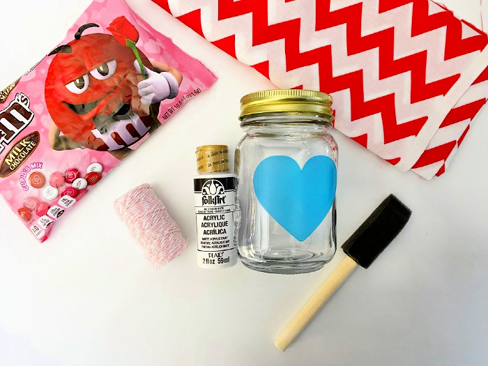 add heart sticker to Mason jar gifts